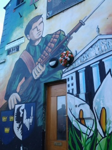 One of many murals in Belfast, Northern Ireland showing the revolutionary cause against England.