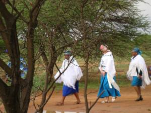 Women walk through the homestead in Gaborone, Botswana.