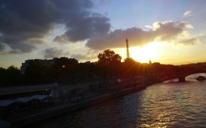 From the vista of Pont Alexandre III, you can see the sun descend on a Parisian day perfectly at twilight.